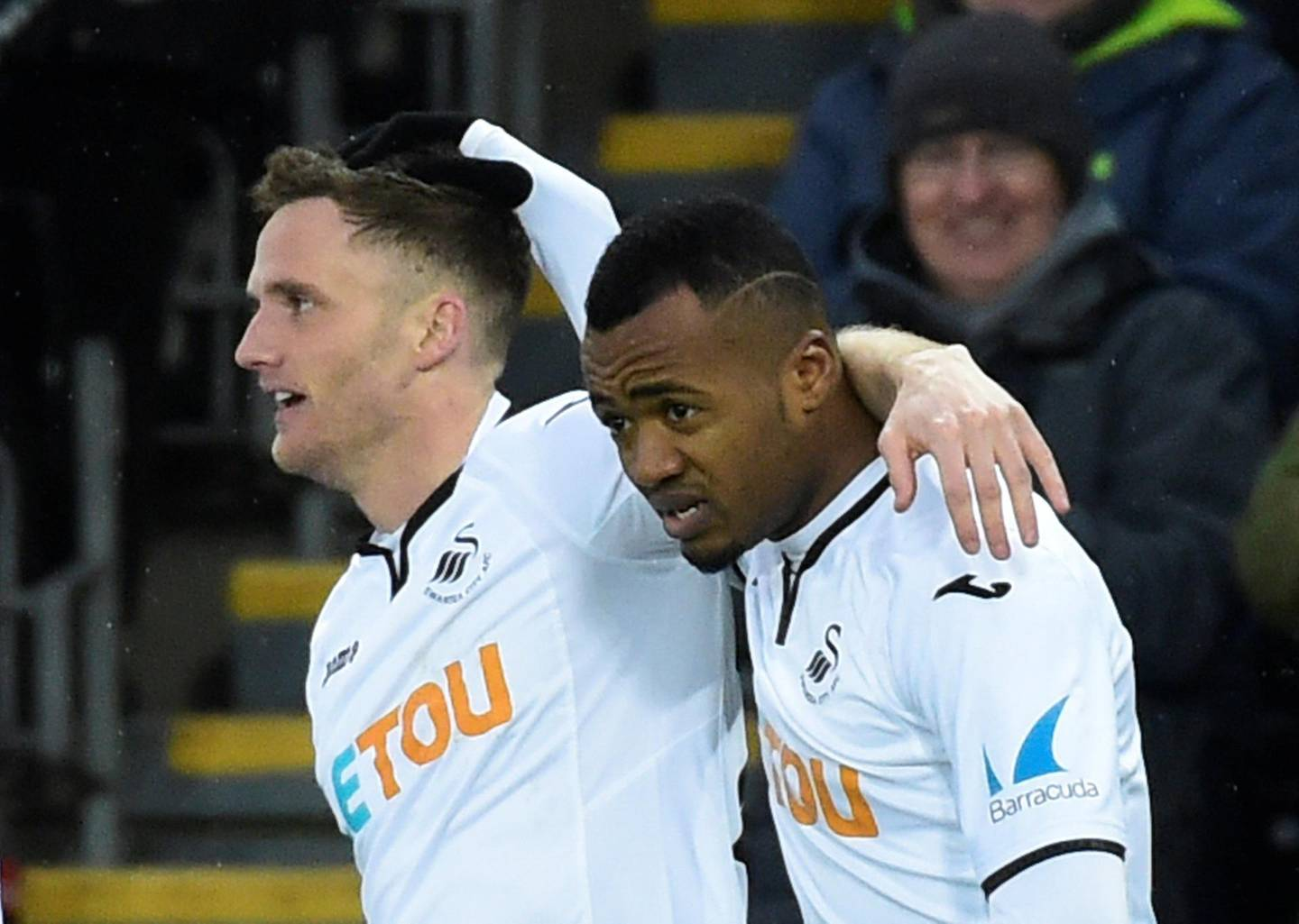"""Soccer Football - Premier League - Swansea City vs West Ham United - Liberty Stadium, Swansea, Britain - March 3, 2018   Swansea City's Andy King celebrates scoring their third goal with Jordon Ayew      REUTERS/Rebecca Naden    EDITORIAL USE ONLY. No use with unauthorized audio, video, data, fixture lists, club/league logos or """"live"""" services. Online in-match use limited to 75 images, no video emulation. No use in betting, games or single club/league/player publications.  Please contact your account representative for further details."""