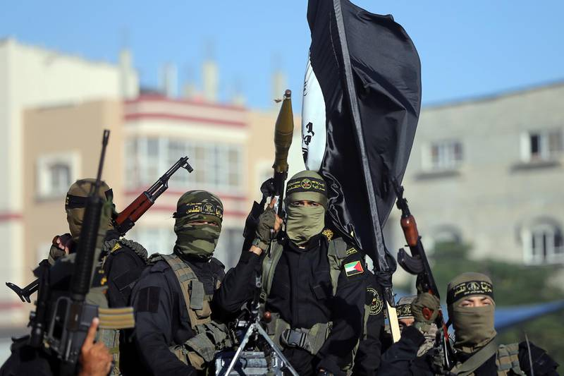 Palestinian Islamic jihad militants take part in a military show marking the 32nd anniversary of the organisation's founding, in the central Gaza Strip October 3, 2019. REUTERS/Ibraheem Abu Mustafa