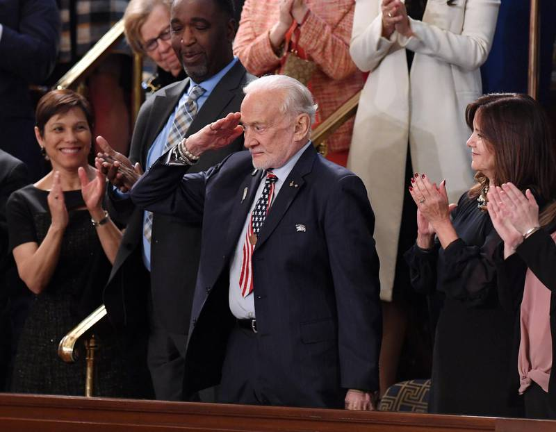Former NASA astronaut Buzz Aldrin salutes as he is recognized by US President Donald Trump during the State of the Union address at the US Capitol in Washington, DC, on February 5, 2019.  / AFP / SAUL LOEB
