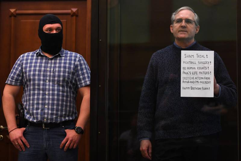 Paul Whelan, a former US marine accused of espionage and arrested in Russia in December 2018, stands inside a defendants' cage as he waits to hear his verdict in Moscow on June 15, 2020. / AFP / Kirill KUDRYAVTSEV