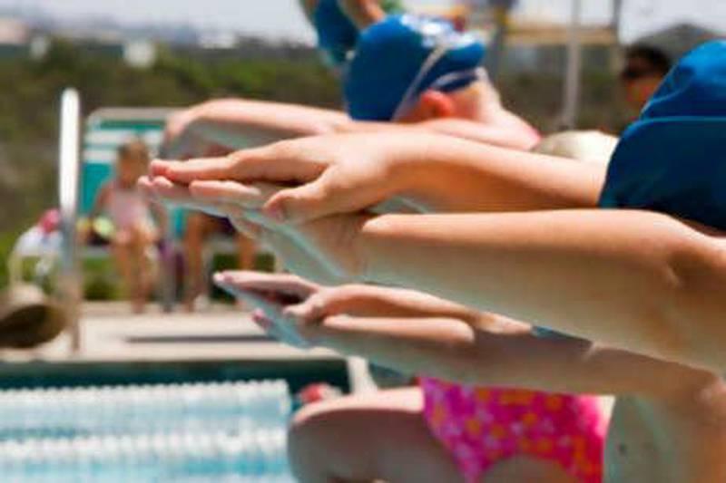 children taking swimming lessons istockphoto.com