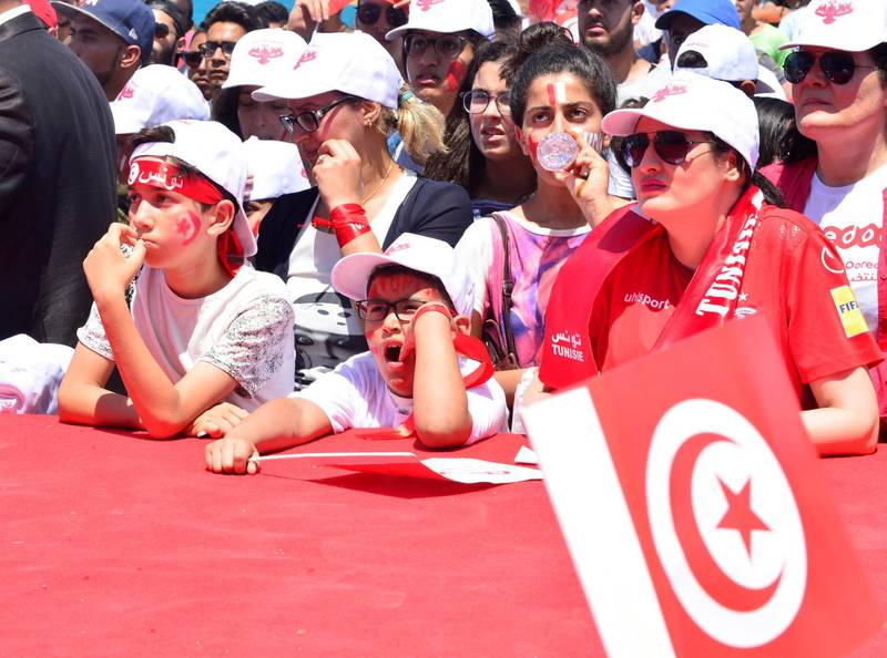 epa06834103 Tunisian fans react as they watch the FIFA World Cup 2018 group G preliminary round match between Belgium and Tunisia, by La Marsa beach, Tunis, Tunisia, 23 June 2018. Tunisia lost by 4-1 to Belgium and got knocked out of the World Cup.  EPA/STR