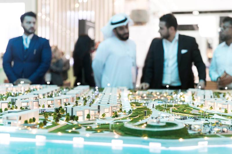 """ABU DHABI, UNITED ARAB EMIRATES - April 16 2019.Al Dar's booth, featuring """"Lea"""" at Cityscape Abu Dhabi 2019.The Abu Dhabi real estate developer is building a new waterfront residential project in the emirate as part of its recently adopted strategy to offer land plots for sale.The 'Lea' scheme is on the northern coast of Yas Island, where Abu Dhabi's Formula One racetrack, the Yas Marina, theme parks and several neighbourhoods including the adjoining Yas Acres development are located.(Photo by Reem Mohammed/The National)Reporter: Gillian DuncanSection: NA + BZ"""