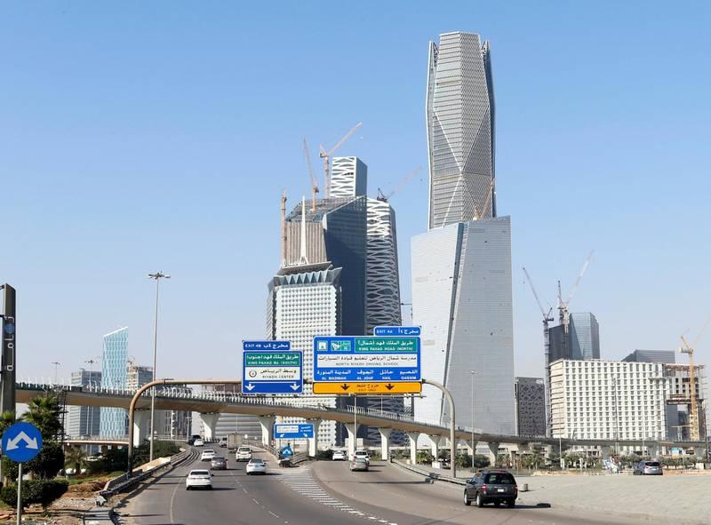 FILE PHOTO: Cars drive past the King Abdullah Financial District in Riyadh, Saudi Arabia December 18, 2018. REUTERS/Faisal Al Nasser/File Photo