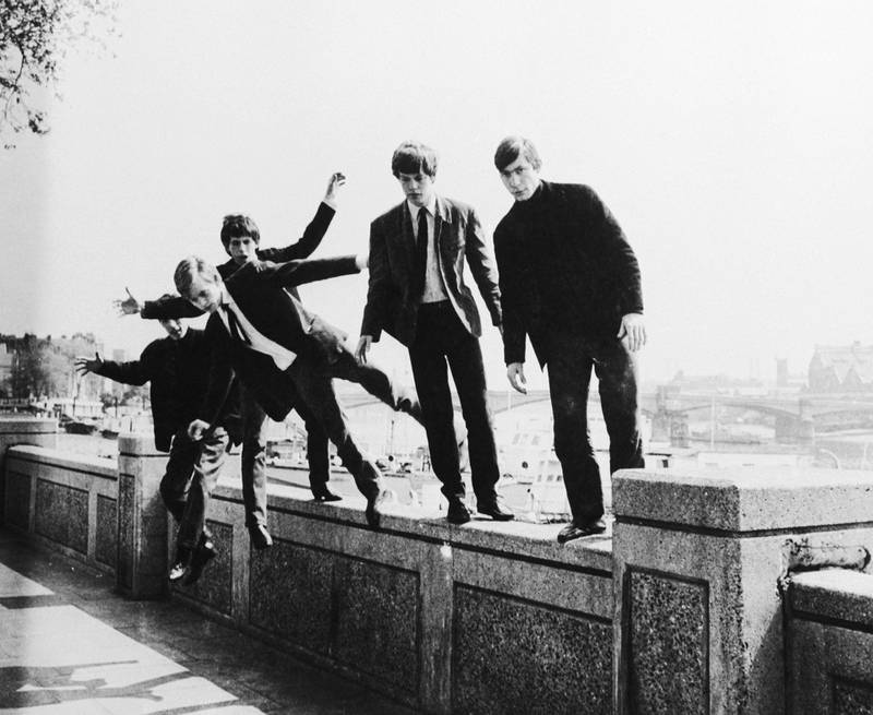 The Rolling Stones messing about on a wall at Embankment, London, circa 1963. (Photo by Keystone Features/Hulton Archive/Getty Images)