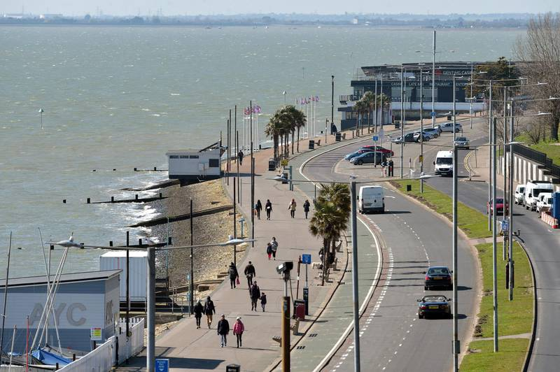 People walk along the promenade in Southend, Essex, as Prime Minister Boris Johnson has said the Government is ready to impose tougher restrictions to curb the spread of the coronavirus if people do not follow the guidance on social distancing. (Photo by Nick Ansell/PA Images via Getty Images)
