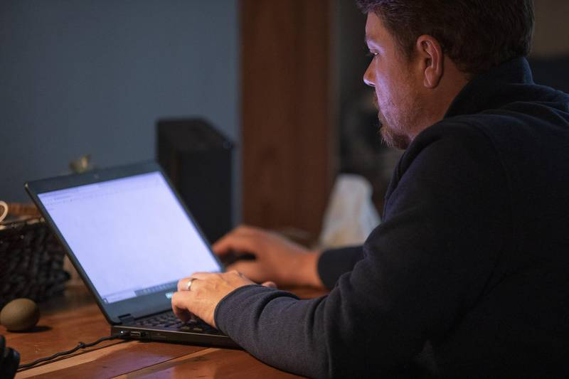 A person works from home on a laptop computer in Princeton, Illinois, U.S., on Friday, Sept. 11, 2020. Illinois reported 1,337 new coronavirus cases Wednesday as the state's positivity rate dropped below 4% for the first time in weeks. Photographer: Daniel Acker/Bloomberg