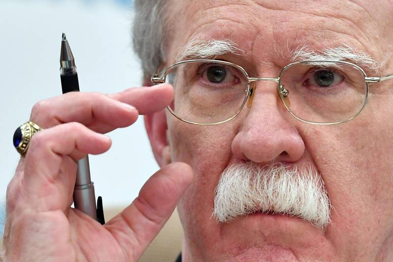 """(FILES) In this file photo taken on October 23, 2018 John Bolton, National Security Adviser to the US President Donald Trump, gives a press conference in Moscow. The White House imposed """"tough"""" new sanctions against Venezuela on November 1, 2018, denouncing Caracas as being part of a """"troika of tyranny"""" that also includes Cuba and Nicaragua. National Security Advisor John Bolton told an audience in Miami the sanctions would particularly target Venezuela's gold sector, which """"has been used as a bastion to finance illicit activities, to fill its coffers and to support criminal groups.""""  / AFP / Yuri KADOBNOV"""
