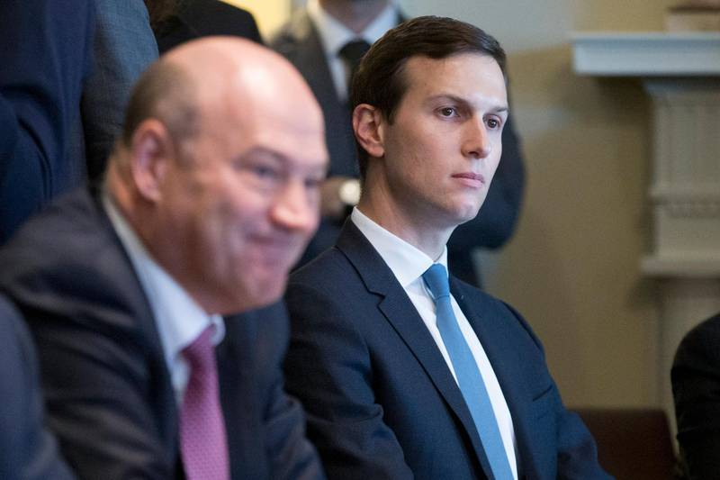 epa06522183 Senior Advisor to President Trump Jared Kushner (R) and Director of the National Economic Council and chief economic advisor to President Trump Gary Cohn (L) attend a meeting on trade and the economy with members of Congress and US President Donald J. Trump (not pictured) in the Cabinet Room of the White House in Washington, DC, USA, 13 February 2018.  EPA/MICHAEL REYNOLDS