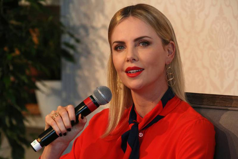 """Actress Charlize Theron speaks at an event at the Global Education and Skills Forum in Dubai, United Arab Emirates, Saturday, March 17, 2018. Theron said Saturday that the idea of arming teachers after recent U.S. school shootings or otherwise """"adding more guns"""" to the situation is """"so outrageous."""" (AP Photo/Jon Gambrell)"""