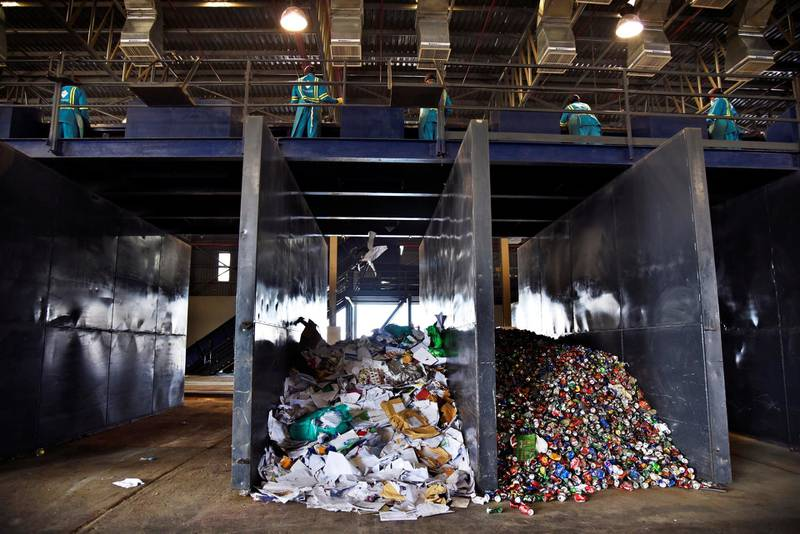 Workers at the Material Recovery Facility sort through garbage during its opening ceremony in Ras Al Khaimah, UAE, Wednesday, Nov. 27, 2019. Shruti Jain The National
