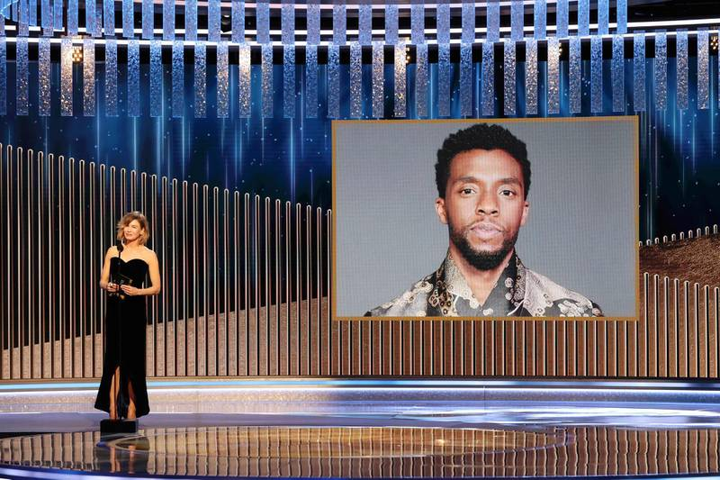 """This handout photo courtesy of NBCUniversal shows Renée Zellweger announces the late Chadwick Boseman as winner of the Best Actor - Motion Picture Drama award for """"Ma Rainey's Black Bottom"""" at the 78th Annual Golden Globe Awards held at the Beverly Hilton Hotel on February 28, 2021. Usually a star-packed, laid-back party that draws Tinseltown's biggest names to a Beverly Hills hotel ballroom, this pandemic edition will be broadcast from two scaled-down venues, with frontline and essential workers among the few in attendance. - RESTRICTED TO EDITORIAL USE - MANDATORY CREDIT """"AFP PHOTO /NBCUniversal / Christopher POLK"""" - NO MARKETING NO ADVERTISING CAMPAIGNS - DISTRIBUTED AS A SERVICE TO CLIENTS --- NO ARCHIVE ---   / AFP / NBCUniversal / Christopher POLK / RESTRICTED TO EDITORIAL USE - MANDATORY CREDIT """"AFP PHOTO /NBCUniversal / Christopher POLK"""" - NO MARKETING NO ADVERTISING CAMPAIGNS - DISTRIBUTED AS A SERVICE TO CLIENTS --- NO ARCHIVE ---"""