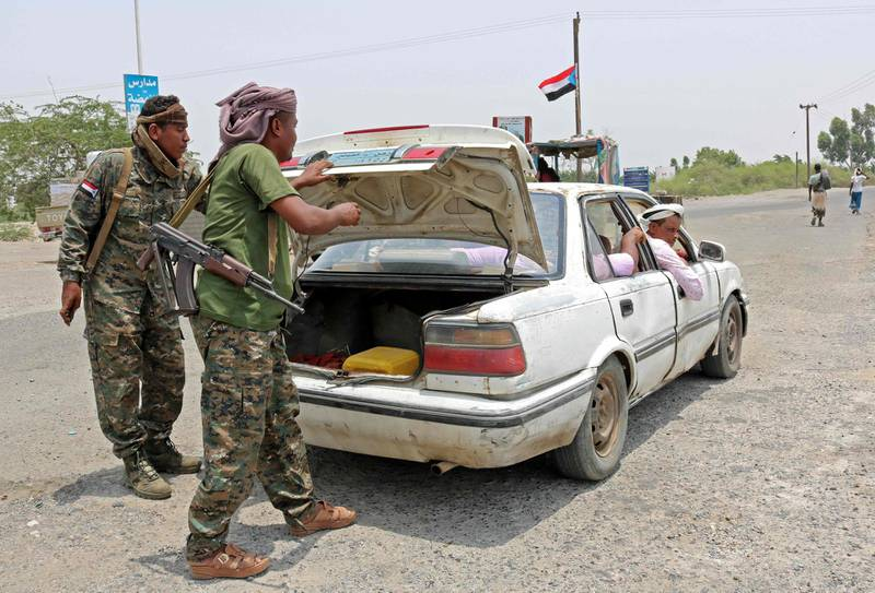 Fighters with the UAE-trained Security Belt Forces loyal to the pro-independence Southern Transitional Council (STC) search the trunk of a car at their checkpoint near the south-central coastal city of Zinjibar in south-central Yemen, in the Abyan Governorate, on August 21, 2019.   Yemeni separatists drove government troops out of two military camps in deadly clashes yesterday, reinforcing their presence in the south after they seized the de facto capital Aden. / AFP / Nabil HASAN
