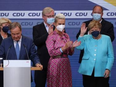 Voters go to the polls in German elections - in pictures