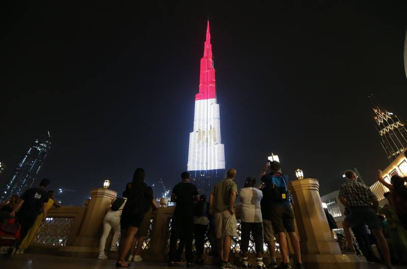 epa07736075 The World's tallest skyscraper Burj Khalifa is illuminated in the colors of the Egyptian flag to mark the Egyptian national day in Dubai, United Arab Emirates, 23 July 2019. Egypt celebrates annually on 23 July the revolution of 1952 that removed the Royal rule and led to the creation of the first Egyptian republic.  EPA/ALI HAIDER