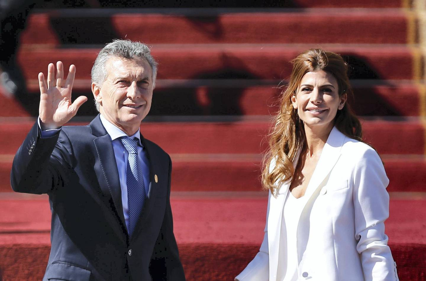 Argentine President Mauricio Macri (L) and First Lady Juliana Awada arrive at the Congress in Valparaiso, Chile, for the inauguration of Chile's new president Sebastian Pinera, on March 11, 2018. / AFP PHOTO / PABLO VERA LISPERGUER