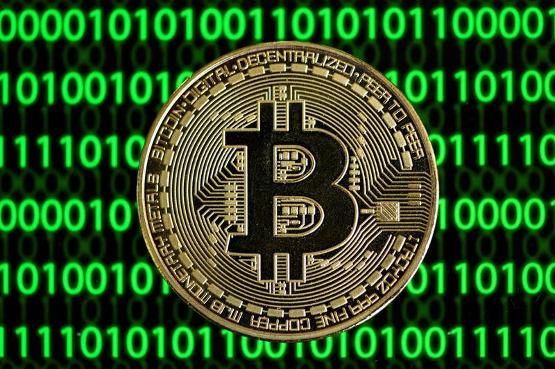 (FILES) In this file photo taken on January 26, 2020 The photo shows a physical imitation of a Bitcoin in Dortmund, western Germany.  Bitcoin has enjoyed a record-breaking week after electric carmaker Tesla and Wall Street finance giants sparked a goldrush for the world's most popular virtual currency, but bubble fears persist. The cryptocurrency topped $52,000 on March 17, 2021 after investment fund giant BlackRock also confirmed a push into the booming sector. / AFP / INA FASSBENDER