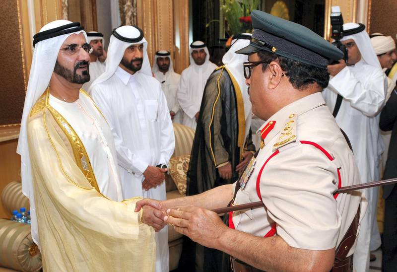 Sheikh Mohammed bin Rashid al-Maktoum (L), Vice President and Prime Minister of the United Arab Emirates and Ruler of Dubai, and his brother Sheikh Ahmed bin Rashid al-Maktoum (2nd L), greet Lieutent General of Dubai Police, Dhahi Khalfan Tamim (R), at the Zabeel Palace in Dubai on September 30, 2008 on the occasion of Eid Al-Adha. The three-day festival, which begins after the sighting of a new crescent moon, marks the end of the Muslim fasting month of Ramadan, during which devout Muslims abstain from food, drink, smoking and sex from dawn to dusk. AFP PHOTO/STR (Photo by AFP)