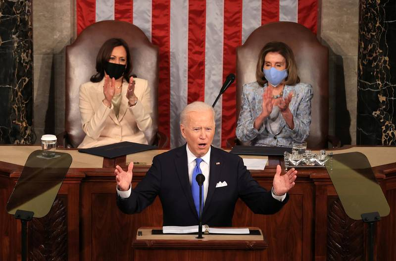 U.S. President Joe Biden addresses a joint session of Congress as President Kamala Harris and Speaker of the House U.S. Rep. Nancy Pelosi (D-CA) aplause at the U.S. Capitol in Washington, DC, U.S. April 28, 2021. Chip Somodevillaat/Pool via REUTERS