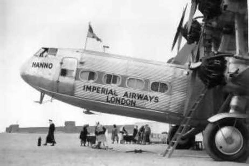 20th April 1934:  The Imperial Airways 'Hanno', Handley Page passenger aeroplane, carrying the England to India Airl mail, refuells at a desert stopover at Port Sharjah at Tricuial Oman, in the Persian Gulf.  (Photo by Fox Photos/Getty Images)