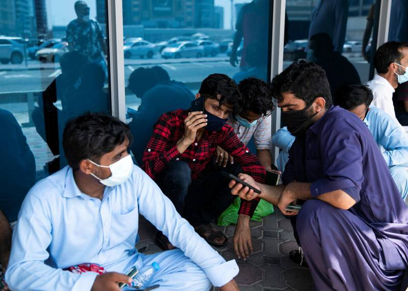 DUBAI, UNITED ARAB EMIRATES. 18 June 2020. Pakistani citizens who live in Dubai line up outside Dnata. They've received a confirmation call from the consulate regarding their repatriation flights. Some are flying back tonight.(Photo: Reem Mohammed/The National)Reporter:Section: