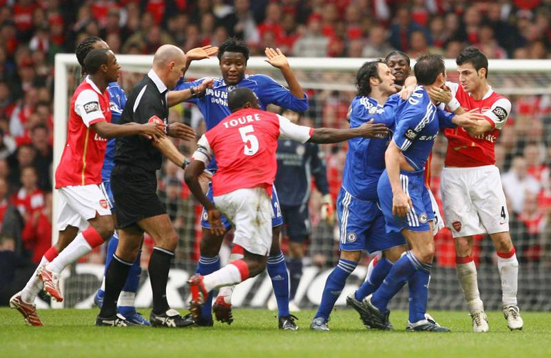CARDIFF, UNITED KINGDOM - FEBRUARY 25:  Referee Howard Webb attempts to difuse a brawl between the  Arsenal and Chelsea players during the Carling Cup Final match between Chelsea and Arsenal at the Millennium Stadium on February 25, 2007 in Cardiff, Wales.  (Photo by Clive Mason/Getty Images)