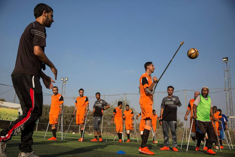 Palestinian players of Gaza's first amputee football team during a practice session held at the municipal ball field of Deir Al Balah ,Gaza on July 16,2018. The team meets weekly and hopes that they can help influence others with similar injuries to over come their disability .The team dreams to compete internationally . Many of the amputees were injured during conflicts with Israel .(Photo by Heidi Levine for The National).