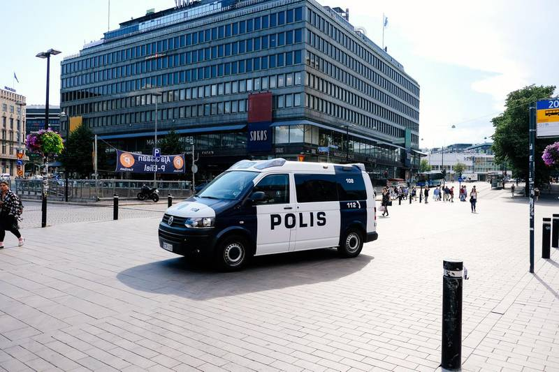 A police van patrols a street near the train station in Helsinki, Finland on July 14, 2018, ahead of the meeting between US President Donald Trump and his Russian counterpart Vladimir Putin.  Finland may have largely shut down for the summer holidays but officials and police have been drafted back into work ahead of a historic summit in Helsinki between Donald Trump and Vladimir Putin.   / AFP / Alessandro Rampazzo