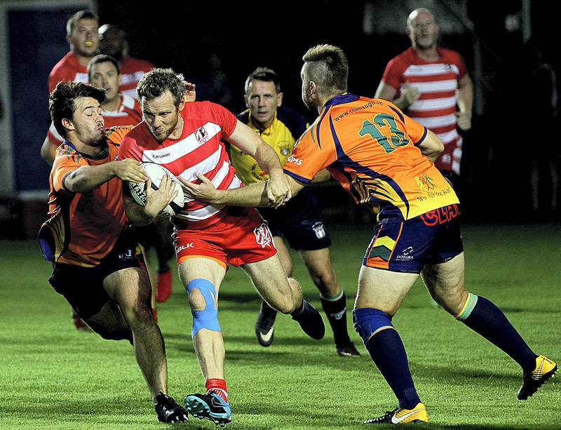 Sharjah, June, 01, 2018: RAK Rugby ( Red& White ) and  Arabian Knights ( Orange&BlacK) in action during the Nick Young Memorial match at the Sharjah Wanderers sports club in Sharjah . Satish Kumar for the National / Story by Paul Radley