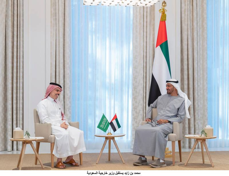 ABU DHABI, UNITED ARAB EMIRATES - May 01, 2021: HH General Sheikh Mohamed bin Zayed Al Nahyan Crown Prince of Abu Dhabi Deputy Supreme Commander of the UAE Armed Forces (R) meets with Prince Faisal bin Farhan, Foreign Minister of Saudi Arabia (L), at Al Shati Palace.( Mohamed Al Hammadi / Ministry of Presidential Affairs )---