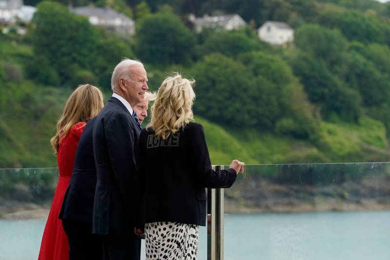 President Joe Biden and first lady Jill Biden are greeted by British Prime Minister Boris Johnson and his wife Carrie Johnson, ahead of the G-7 summit, Thursday, June 10, 2021, in Carbis Bay, England. (AP Photo/Patrick Semansky)