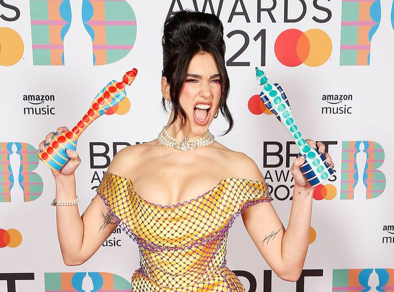 epa09192546 A handout photo made available by the Brit Awards shows Dua Lipa at the Brit Awards 2021 at the O2 Arena in Greenwich, Greater London, Britain, 11 May 2021. It is the 41st edition of the British Phonographic Industry's annual pop music awards.  EPA/JOHN MARSHALL / HANDOUT NO TV / NO USE AFTER 08 JUNE 2021 / MANDATORY CREDIT: JOHN MARSHALL HANDOUT EDITORIAL USE ONLY/NO SALES/NO ARCHIVES