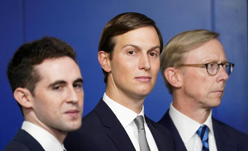 FILE PHOTO: White House adviser Jared Kushner, flanked by aide Avi Berkowitz (L) and Brian Hook, former U.S. envoy to Iran, during a press briefing on the agreement between Israel and the United Arab Emirates at White House in Washington, U.S., August 13, 2020.  REUTERS/Kevin Lamarque/File Photo