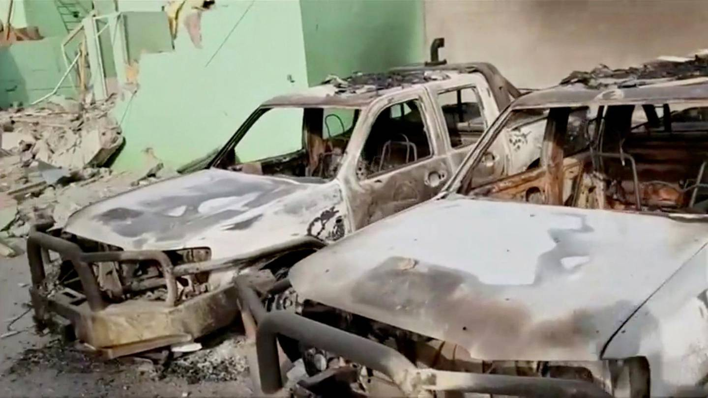 Destroyed security vehicles in Ghazni City, Afghanistan are seen in this still image taken from a video by Ariana News on August 13, 2018. Ariana News via REUTERS TV  ATTENTION EDITORS - THIS IMAGE HAS BEEN PROVIDED BY A THIRD PARTY. AFGHANISTAN OUT.