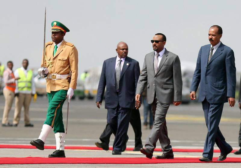 Eritrea's President Isaias Afwerki is welcomed by Ethiopian Prime Minister Abiy Ahmed upon arriving for a three-day visit, at the Bole international airport in Addis Ababa, Ethiopia July 14, 2018. REUTERS/Tiksa Negeri