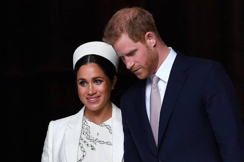 """(FILES) In this file photo taken on March 11, 2019 Britain's Prince Harry, Duke of Sussex (R) and Meghan, Duchess of Sussex leave after attending a Commonwealth Day Service at Westminster Abbey in central London.  Prince Harry will produce a documentary about the Invictus Games for disabled military veterans -- the first series under a lucrative deal he and  wife Meghan Markle signed with Netflix after moving to California last year.  Harry, who served with the British military in Afghanistan, will appear on camera and executive-produce """"Heart of Invictus,"""" a multi-episode series which follows competitors as they train for next spring's competition in The Hague.  / AFP / Ben STANSALL"""