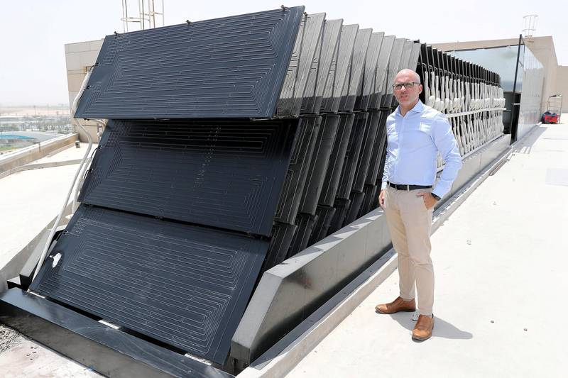 ABU DHABI , UNITED ARAB EMIRATES , MAY 28 – 2018 :- Hugo Domingues explaining about the Thermos Dynamic Solar panels which are installed on the roof top of Radisson Hotel at Yas Island in Abu Dhabi.  ( Pawan Singh / The National )  For News. Story by Nick Webster