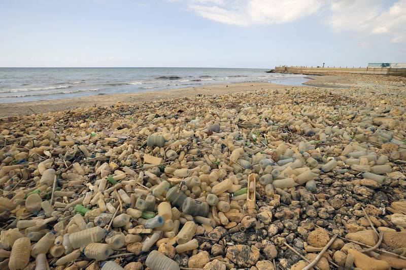 Piles of plastic waste are pictured on the seaside in the coastal town of Khalde, south of the Lebanese capital Beirut, on September 22, 2016. (Photo by JOSEPH EID / AFP)