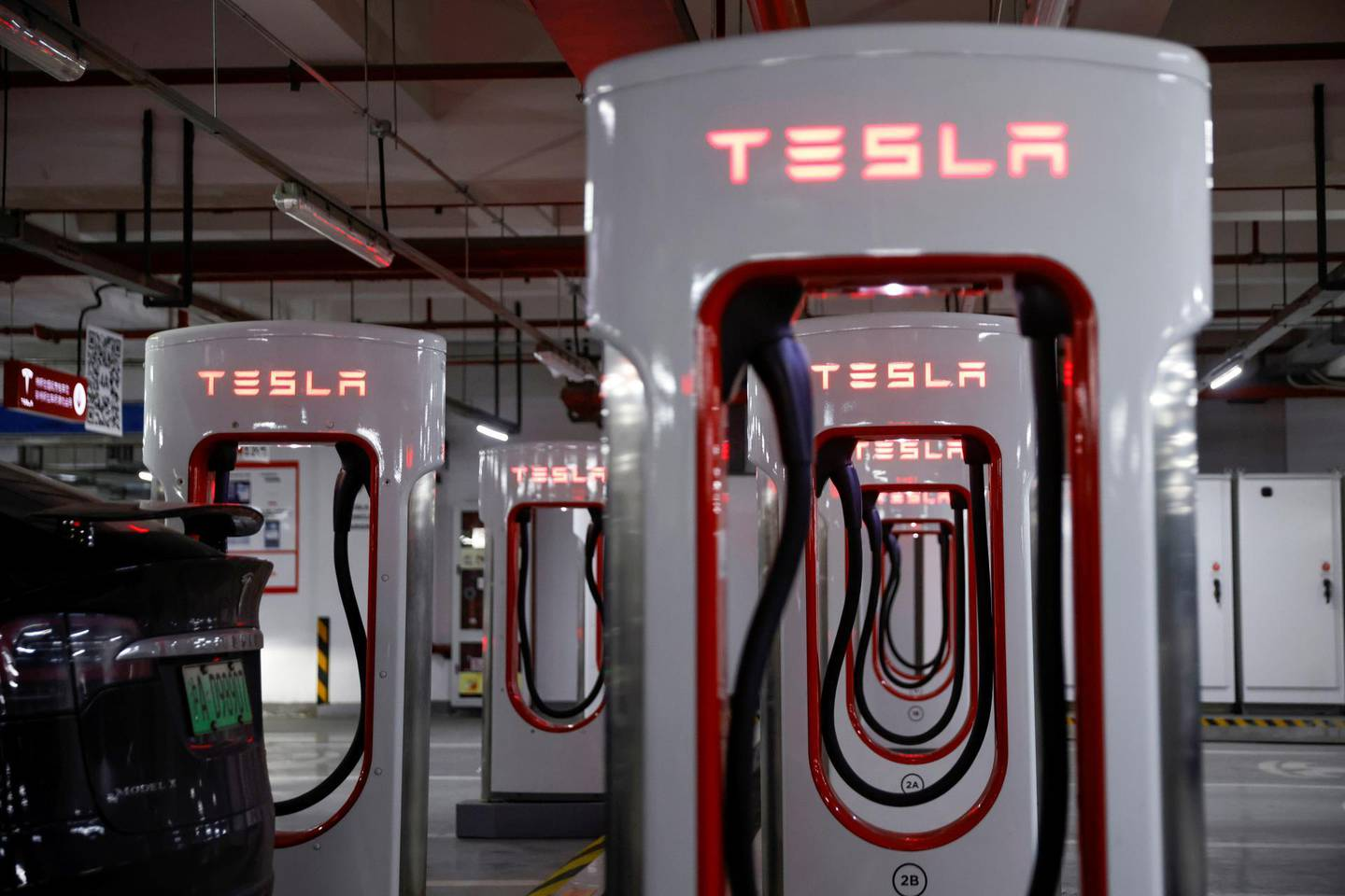 FILE PHOTO: Tesla charging stations are pictured in a parking lot in Shanghai, China March 13, 2021. Picture taken March 13, 2021. REUTERS/Aly Song/File Photo