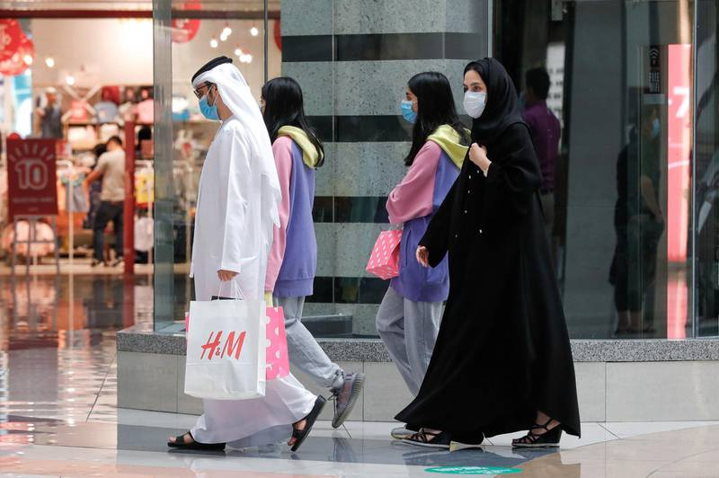 Abu Dhabi, United Arab Emirates, August 2, 2020.    A family goes shopping at Al Wahda Mall on the last day of Eid Al Adha. Victor Besa /The NationalSection: NAFor:  Standalone/Stock Images