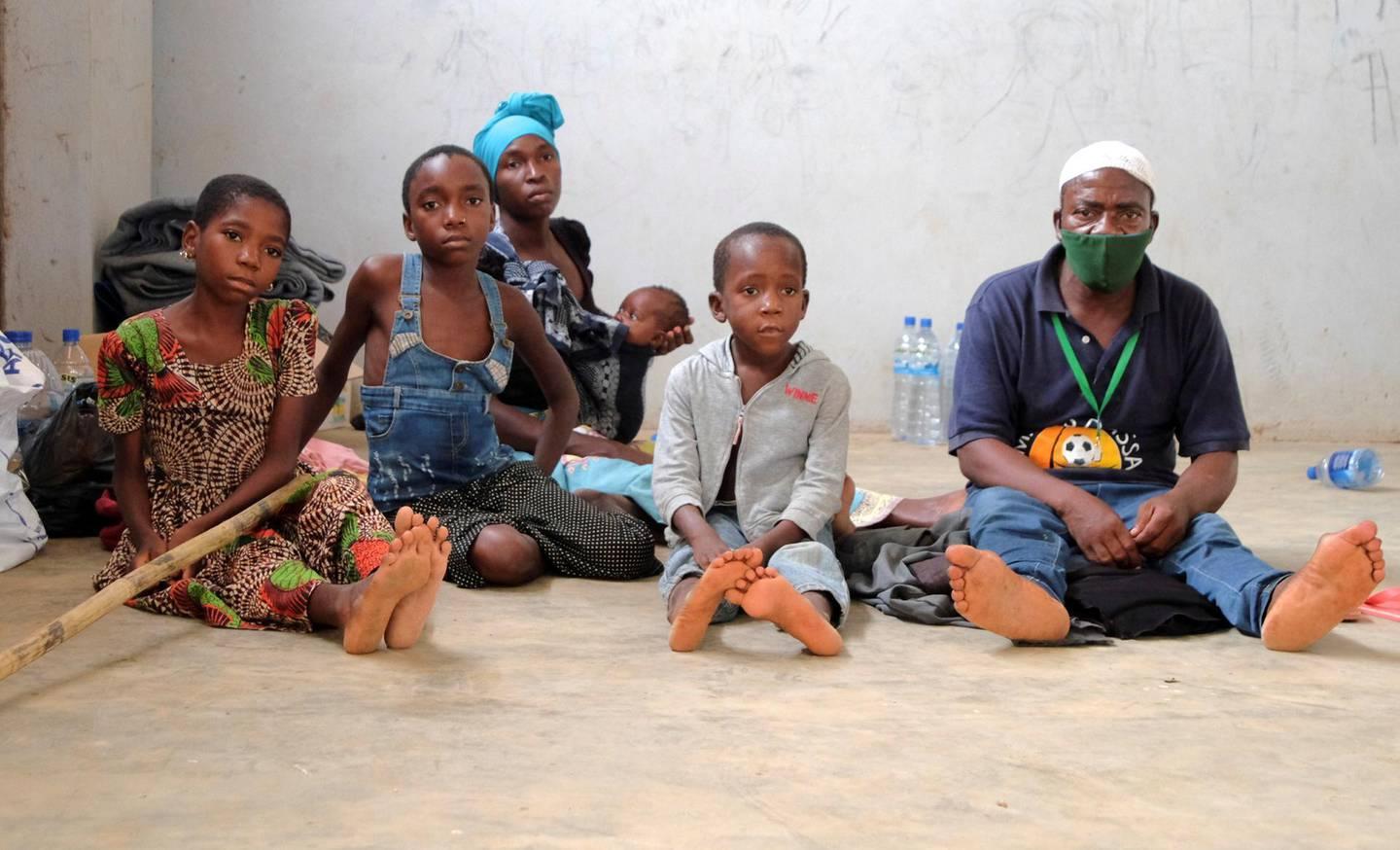 Adelino Alberto and his family who fled an attack claimed by Islamic State-linked insurgents on the town of Palma, are seen at a temporary displacement centre in Pemba, Mozambique, April 3, 2021. Picture taken April 3, 2021. REUTERS/Emidio Jozine NO RESALES. NO ARCHIVES