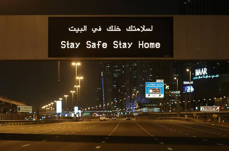 DUBAI, UNITED ARAB EMIRATES , April 05 – 2020 :- Stay Safe Stay Home message on Sheikh Zayed road in Dubai.  Dubai is conducting 24 hours sterilisation programme across all areas and communities in the Emirate and told residents to stay at home. UAE government told residents to wear face mask and gloves all the times outside the home. (Pawan Singh / The National) For News/Online/Instagram.