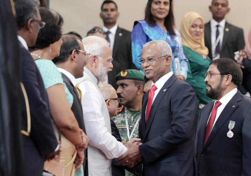 Indian Prime Minister Narendra Modi, center left, congratulates Maldives' new President Ibrahim Mohamed Solih after his swearing-in ceremony in Male, Maldives, Saturday, Nov. 17, 2018. Thousands of people cheered Solih, from the Maldivian Democratic Party, at a swearing-in ceremony Saturday in a soccer stadium chosen to accommodate a large number of his supporters. (AP Photo/Mohamed Sharuhaan)
