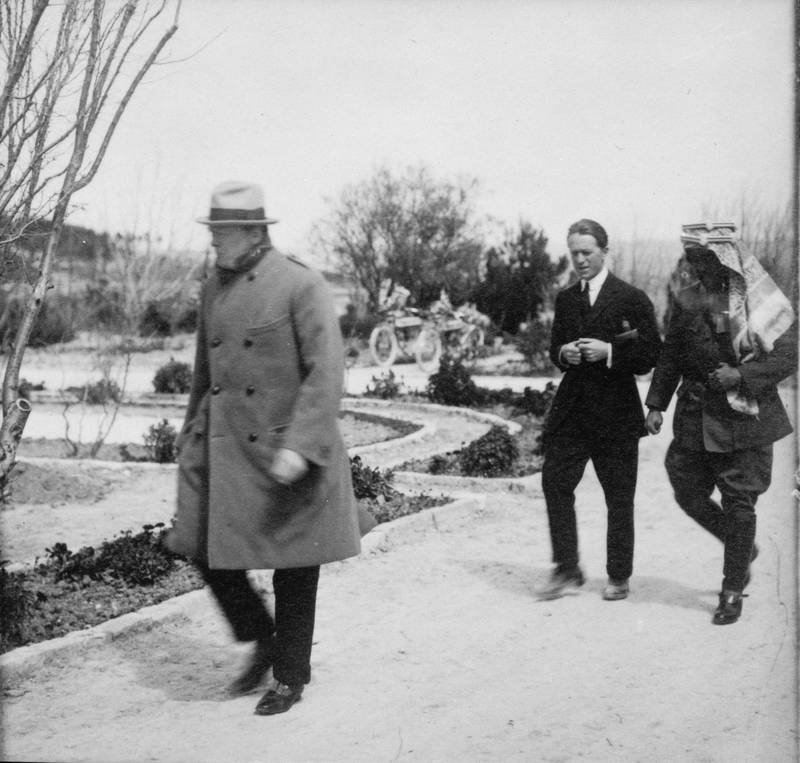 T.E. Lawrence walking with Emir Abdullah in the garden of Government House, Jerusalem, as Winston Churchill walks ahead of them. Courtesy Library of Congress, Prints & Photographs Division