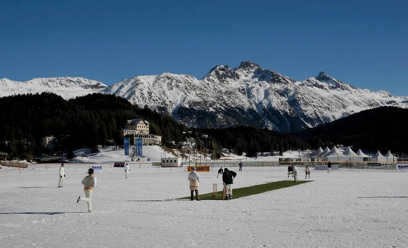 ST. MORITZ, SWITZERLAND - FEBRUARY 02: (EDITOR'S NOTE: AN ON-CAMERA POLARIZING FILTER WAS USED TO CREATE THIS IMAGE)  Winterthur XI play Old Salopians XI during the 19th Cricket Tournament on Ice held on the frozen surface of Lake St. Moritz on February 2, 2007 in St. Moritz, Switzerland. The tournament first took place in 1988, when a group of Britons challenged the students of the international boarding school Lyceum Alpinum Zuoz to a game. Since then it has become an integral part of the cricket calendar, attracting international players and high-flying businessmen from all over the world. (Photo by Scott Barbour/Getty Images)