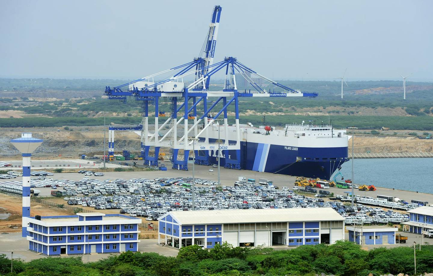 TO GO WITH SriLanka-economy-infrastructure,FOCUS by Amal Jayasinghe  In this photograph taken on February 10, 2015, shows a general view of the port facility at Hambantota.  From a multi-million dollar airport ignored by airlines to a lavish cricket stadium rejected by players, Sri Lanka's new government is mulling the future of a string of white elephants.      AFP PHOTO / LAKRUWAN WANNIARACHCHI / AFP PHOTO / LAKRUWAN WANNIARACHCHI
