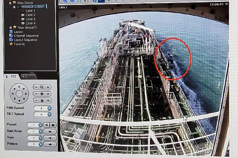 """A CCTV footage of the Hankuk Chemi, a South Korean-flagged oil tanker, is displayed on a screen as a boat of Iran's Revolutionary Guards is seen in red circle on the screen at the tanker's owner company DM Shipping, in Busan on January 4, 2021. South Korea's foreign ministry on January 4 demanded the """"early release"""" of an oil tanker seized by Iran in Gulf waters for breaking maritime environmental laws. -  - South Korea OUT / REPUBLIC OF KOREA OUT  NO ARCHIVES  RESTRICTED TO SUBSCRIPTION USE      / AFP / YONHAP / - / REPUBLIC OF KOREA OUT  NO ARCHIVES  RESTRICTED TO SUBSCRIPTION USE"""