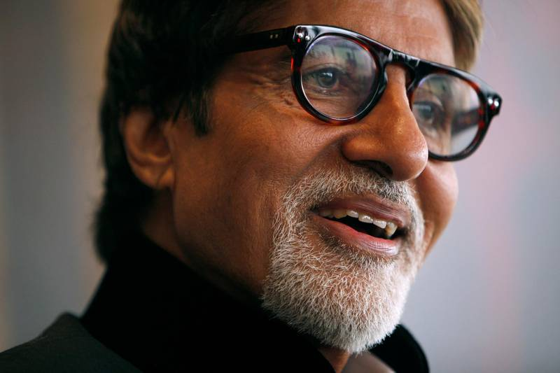 FILE PHOTO: Indian actor Amitabh Bachchan reacts during the Asian Film Awards news conference in Hong Kong March 23,2010. REUTERS/Tyrone Siu/File Photo