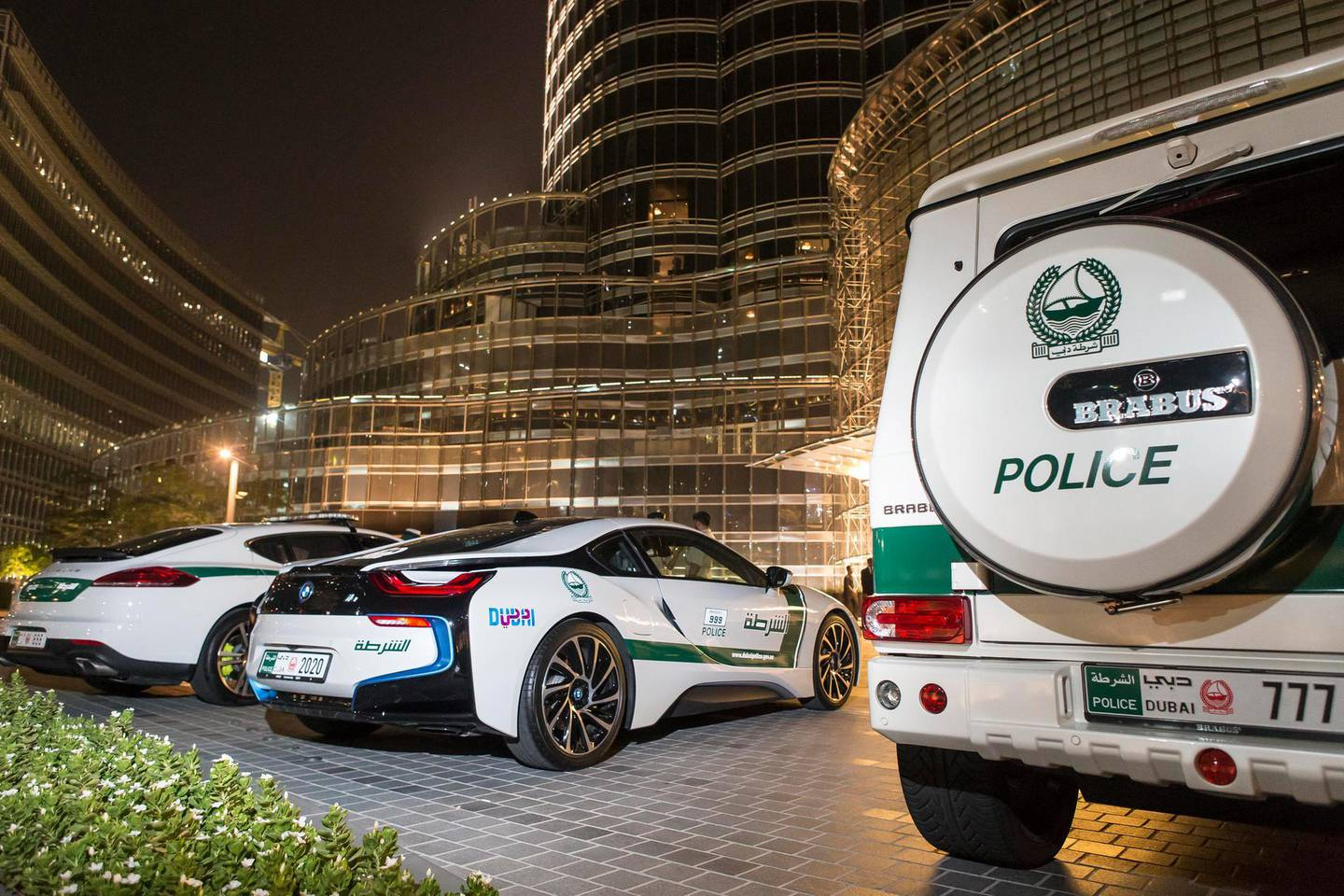 DUBAI, UNITED ARAB EMIRATES, 16 JULY 2015. The Dubai Police super luxury cars. A quick drive with Dubai Police in their BMW I8, Porche Panamera and Mercedes GWagon Brabus that ended in a photo opertunity at the Dubai Mall Fountain where members of the public had a chance to see the cars and interact with the police. (Photo: Antonie Robertson/The National) Journalist: Dana Moukhallati. Section: National. *** Local Caption ***  AR_1607_Police_Luxury_Cars-01.JPG