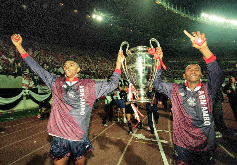 VIENNA - MAY 24:  Nwankwo Kanu (left) and Finidi George (right) of Ajax lift the cup up after the European Cup Final between AC Milan and Ajax held on May 24, 1995 in Vienna, Austria. Ajax won the match and cup 1-0. (Photo by Clive Brunskill/Getty Images)